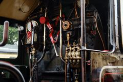 Engine room on steam train, Dartmouth, Devon, United Kingdom, May 24, 2018 stock photography