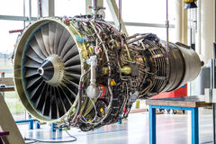 Engine's maintenance in huge industrial hall Stock Photos