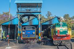 Engine sheds on an Indian mountain railway. Coonoor, India - March 5, 2018: Engines employed on the UNESCO World Heritage Nilgiri Mountain railway being stock photos