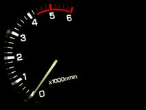 Engine speed. Meter on a black background Stock Image