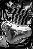Engine of a sports motorcycle Norton Commando 961 Cafe Racer. BERLIN, GERMANY - MAY 17, 2014: Engine of a sports motorcycle Norton Commando 961 Cafe Racer. Black stock image
