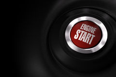 Engine start button - car. Car engine start button over a black background with copy space on the left side of the image Stock Photos