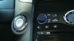 Engine start button. Engine start stop button from a modern car interior stock footage