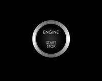 Engine start/stop button. Black and silver engine start/stop button Stock Image