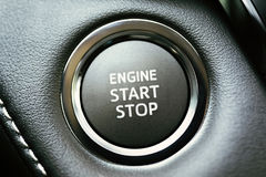 Engine start stop button. On car dashboard Royalty Free Stock Photography