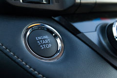 Engine Start Stop. Button of a modern car Stock Photos