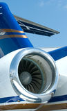 Engine and tail detail of business jet. Royalty Free Stock Photos