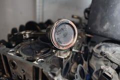 Engine valve car maintenance. A deposit on a piston, a large run a long service life.  Stock Photos