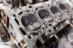Engine valve car maintenance. A deposit on a piston, a large run a long service life.  Royalty Free Stock Image