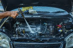High Pressure Water engine Washing,Cleaning. Engine Washing,Cleaning Car Using High Pressure Water blur Stock Image