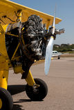 Engine on yellow biplane at airport Royalty Free Stock Photos