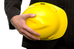 Engineer. Holding yellow a helmet Royalty Free Stock Images