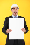 Engineer. Looking at a board in shock Stock Images