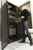 IT Engineer. A fast working IT engineer / technician installing a blade server in a rack at the data center stock photos