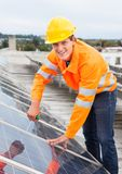 Engineer Adjusting Solar Panels Royalty Free Stock Image