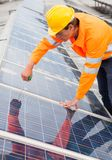 Engineer adjusting solar panels Stock Images