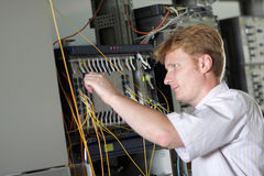 Engineer adjusts multiplexer Royalty Free Stock Image