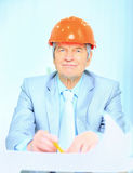 Engineer at the age of considering plans Stock Image
