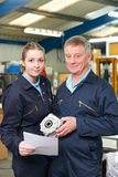 Engineer And Apprentice With Component In Factory Stock Photos