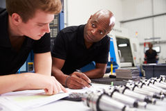 Engineer And Apprentice Planning CNC Machinery Project Royalty Free Stock Image