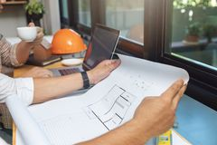 Engineer and Architect concept, Engineer Architects and real estate agent office team working with blueprints.  stock photo