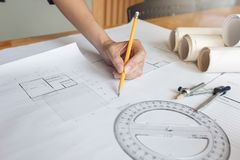 Engineer and Architect concept, Engineer Architects and real estate agent office team working with blueprints.  royalty free stock photography