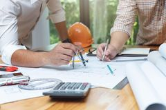 Engineer and Architect concept, Engineer Architects and real estate agent office team working with blueprints.  royalty free stock images