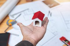 Engineer and Architect concept, Engineer Architects and real estate agent office team working with blueprints.  royalty free stock image