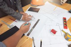 Engineer and Architect concept, Engineer Architects and real estate agent office team working with blueprints.  stock images