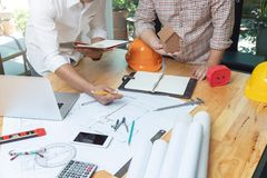 Engineer and Architect concept, Engineer Architects and real estate agent office team working with blueprints.  stock image