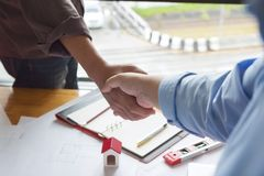 Engineer and Architect concept, Engineer Architects and real estate agent office team shaking hands in office.  royalty free stock image