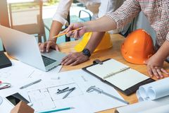 Engineer and Architect concept, Engineer Architects and real estate agent office team working with blueprints.  royalty free stock photo