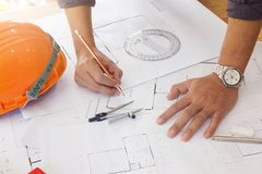 Engineer and Architect concept, Engineer Architects and real estate agent office team working with blueprints.  royalty free stock photos