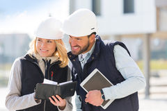 Engineer and architect dating next appointment on a construction. View of a Engineer and architect dating next appointment on a construction site Stock Photo