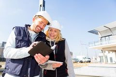 Engineer and architect dating next appointment on a construction Stock Photos