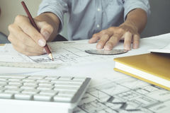 Engineer or architect hand to drawings building project Stock Image