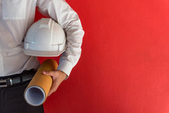 Engineer or Architect holding safety helmet and drawing Stock Photos