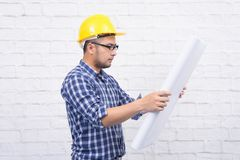 Engineer or Architect man wearing glasses looking on blueprint c royalty free stock photography