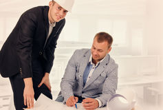 Engineer and Architect Talking About the Blueprint Stock Photo