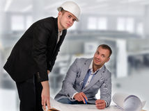 Engineer and Architect Talking About the Blueprint Stock Image