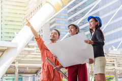 Engineer or Architect team and worker looking paper plans Royalty Free Stock Images