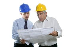Engineer architect two expertise team plan hardhat. Architect engineer two expertise team plan talking hardhat white background stock photography