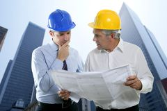 Engineer architect two expertise team plan hardhat Stock Photos