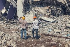 Engineer architect and worker operation control demolish old building.  royalty free stock images
