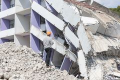 Engineer architect and worker operation control demolish old building.  stock photo