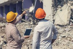 Engineer architect and worker operation control demolish old building.  royalty free stock photo