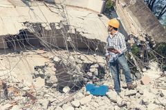 Engineer architect and worker operation control demolish old building.  stock images