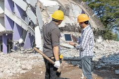 Engineer architect and worker operation control demolish old building.  stock image