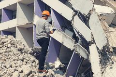 Engineer architect and worker operation control demolish old building.  stock photos