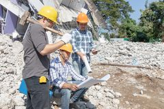 Engineer architect and worker operation control demolish old building.  royalty free stock photos